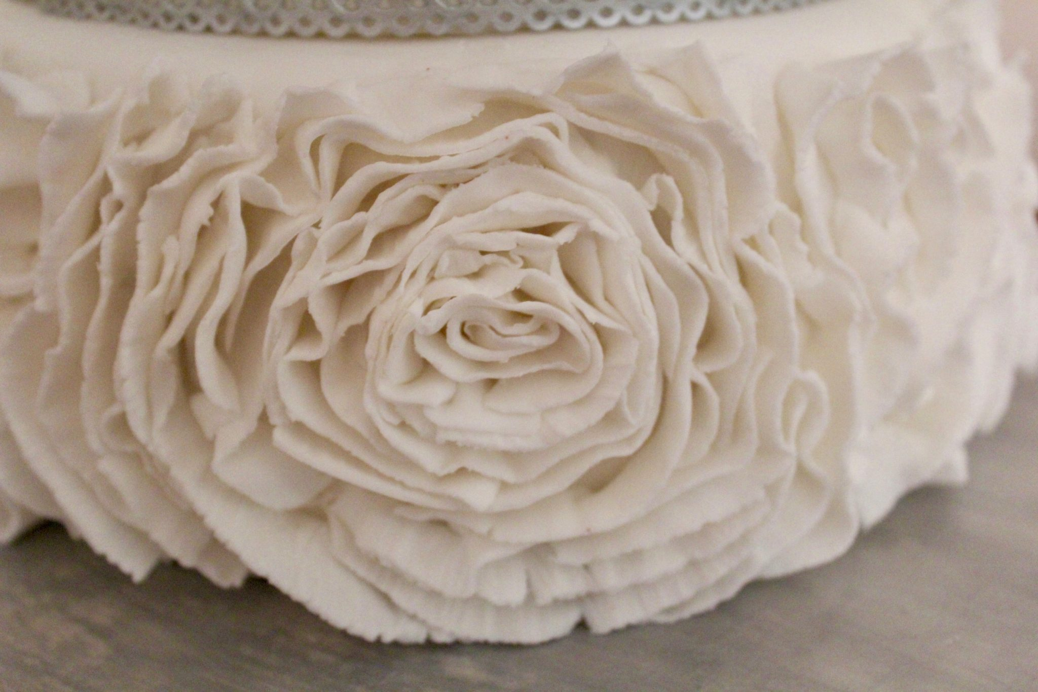 Edible Lace & Ruffles two-tier white and silver Wedding Cake