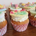 Easter cute cupcakes with bunnies, chicks and spring flowers