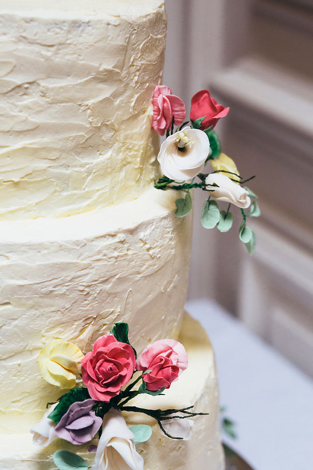 Rustic Buttercream with pastel sugar flowers Wedding Cake