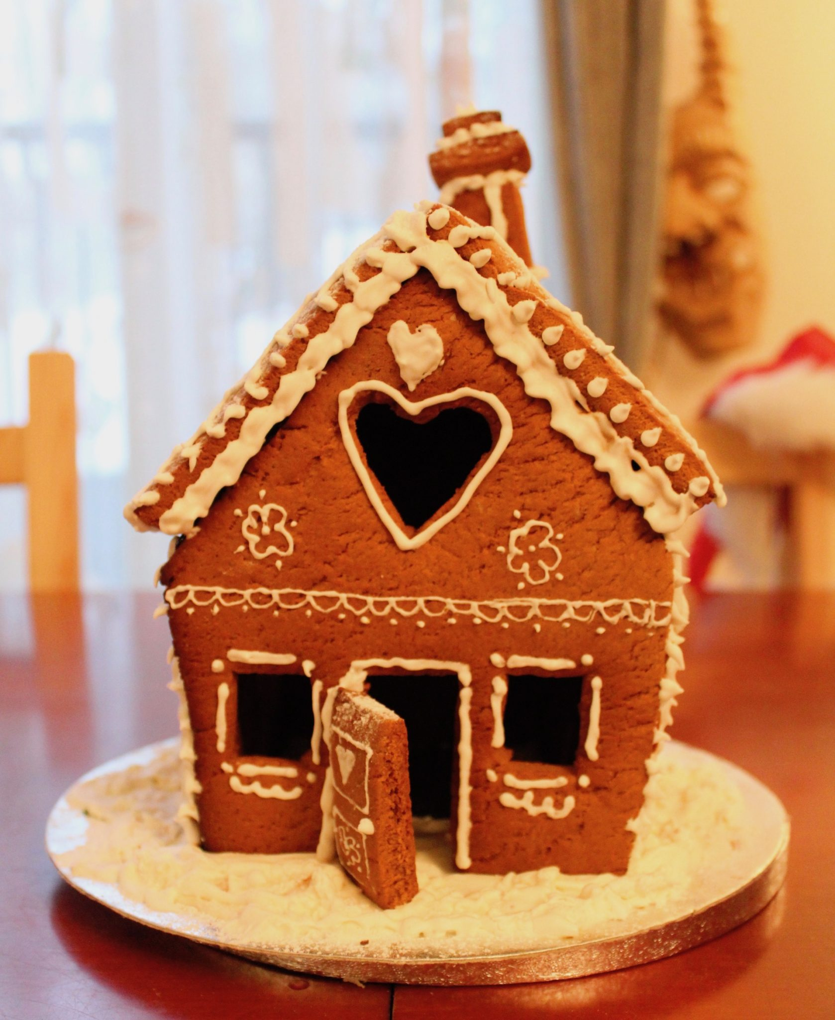 Gingerbread house with piped royal icing frosting