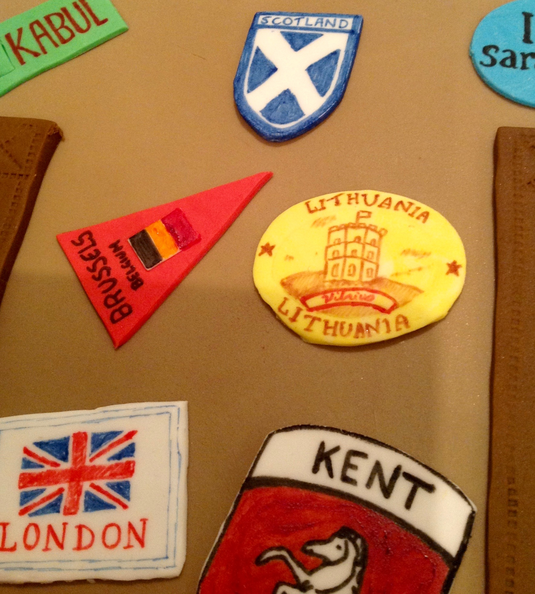 Suitcase travelling farewell cake with country stickers